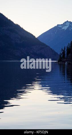 A calm summer sunset on lake Chelan in Washington state. - Stock Photo