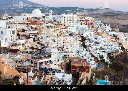 Thira, Santorini Island, Greece - July 19, 2012:  Illuminated Luxury balcony decks and patios with restaurants of - Stock Photo