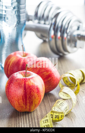 Diet concept. Apple and mesuring tape. - Stock Photo