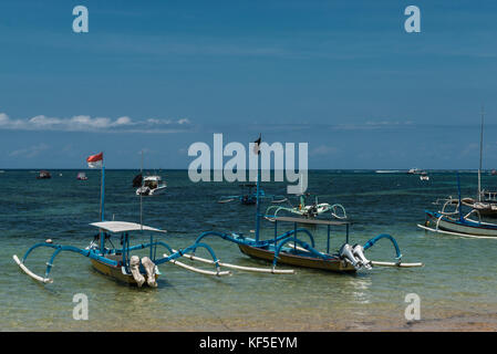 Traditional balinese dragonfly boat on the beach. Jukung fishing boats on Sanur beach, Bali, Indonesia, Asia - Stock Photo