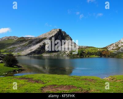 View of Lake Enol at Lakes of Covadonga in Asturias, Spain - Stock Photo