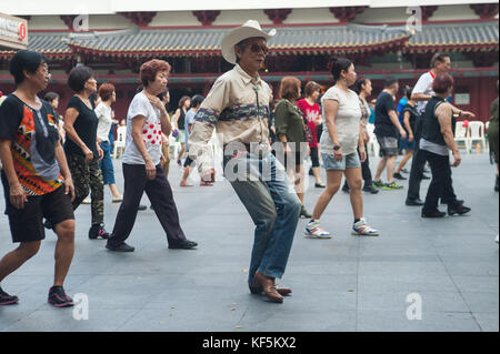 22.10.2017, Singapore, Republic of Singapore, Asia - A group of elderly people meet on Sundays for their line dance - Stock Photo
