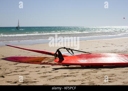 Many color windsurfing lying on the beach. Sea sport activity. - Stock Photo