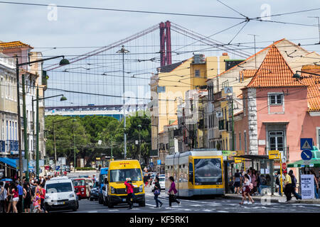 Lisbon Portugal Belem historic district Rua de Belem buildings street crossing traffic tram view of Ponte 25 de - Stock Photo