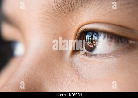 eye looking out to the window - close up of human eye - Stock Photo