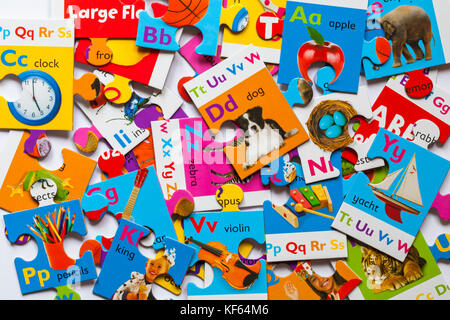 Large Floor Puzzle Alphabet - pile of jigsaw puzzle pieces - Stock Photo