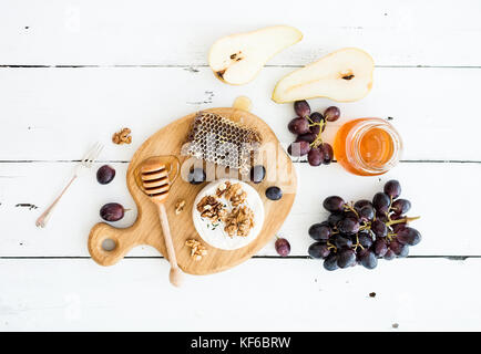 Camembert cheese with grape, walnuts, pear and honey - Stock Photo