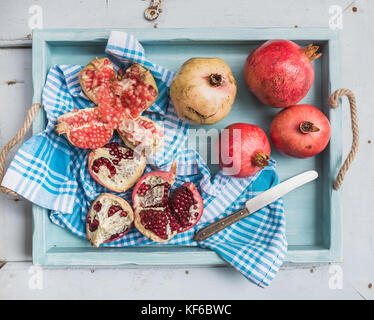 Red and white pomegranates with knife - Stock Photo