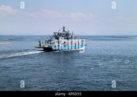 Hiroshima, Japan -  May 26, 2017: A ferry on Seto Inland Sea running to Miyajima Island in Hiroshima, Japan - Stock Photo