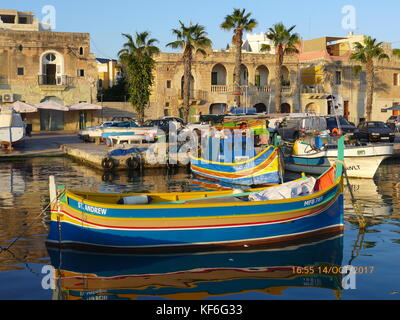 Traditional Maltese wooden fishing boats.anchored at Marsaxlokk, Birzebbuga, Senglea  & Xlendi, Gozo. Malta. Mediterranean - Stock Photo