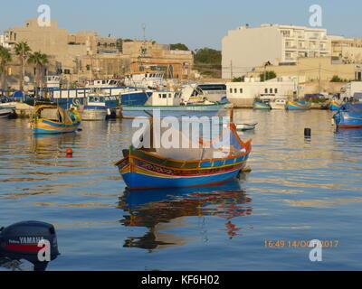 Traditional Maltese wooden fishing boats.anchored at Marsaxlokk, Birzebbuga, Senglea  & Xlendi, Gozo. Malta. Mediterranean - Stock Photo