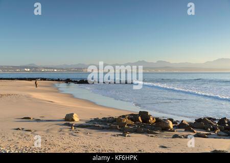 Man walking on beach, Mossel Bay, Western Cape, South Africa