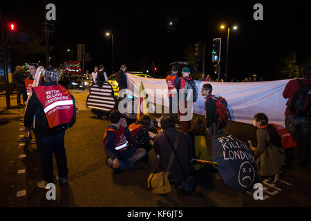 London, UK. 25th Oct, 2017. Environmental activists from the Stop Killing Londoners campaign block a road at Marble - Stock Photo