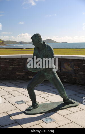 Statue of Kerry footballer in sports gear with football. - Stock Photo