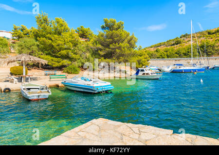 Boats in beautiful sea bay between Sibenik and Primosten towns, Dalmatia, Croatia - Stock Photo