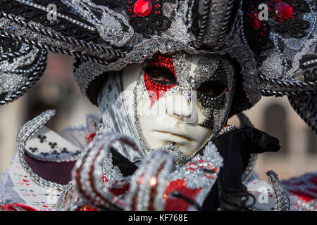 Person in costume wearing a mask at the carnival in Venice, Veneto, Italy, Europe - Stock Photo