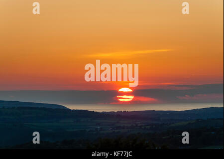 Pembrokeshire, Wales, UK. A glorious summer sunset over St Bride's Bay off the coast of western Pembrokeshire - Stock Photo