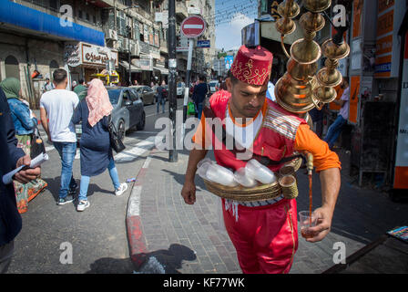 Serving Tea and Coffee  on the Street in Ramallah, Palestine. - Stock Photo