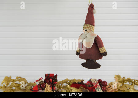 lovely traditional christmas photography image of vintage old worn santa claus father christmas xmas decoration - Stock Photo