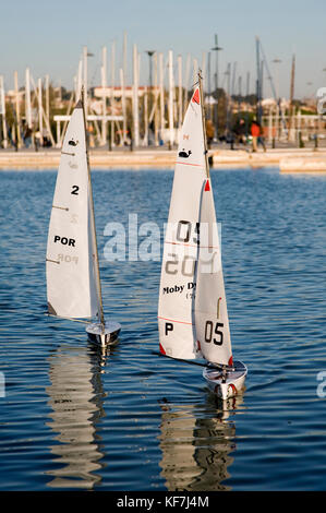 Small radio-controlled boats sailing on the lake surrounding a restaurant in Belém near the marina in Lisbon. Giving - Stock Photo