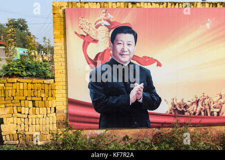 A poster featuring Xi Jinping, China's president, hangs on a wall in a village in Xiong'an New Area, Hebei Province, - Stock Photo