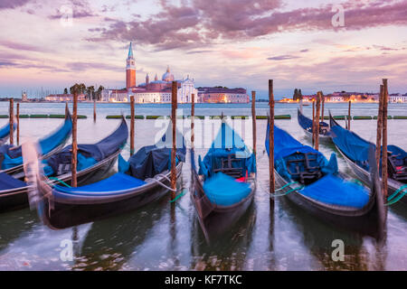 Gondolas Italy venice italy moored gondolas on the Grand Canal Venice opposite the Island of San Giorgio Maggiore - Stock Photo