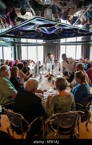 USA, Alaska, Glacier Bay, passengers enjoy dinner together at the Pinnacle Grill, aboard the ms Oosterdam - Stock Photo