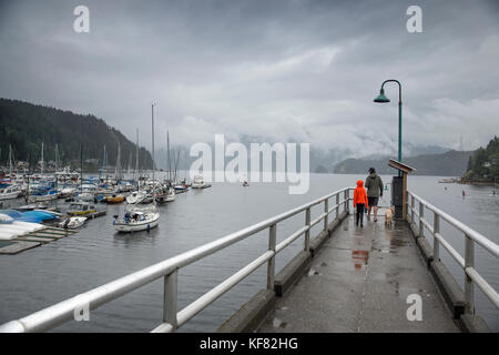 CANADA, Vancouver, British Columbia, father and son walk with their dog on the pier in Deep Cove, North Vancouver - Stock Photo