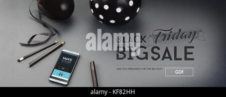 Black Friday sale banner, with black letters, balloon, pencils, ribbon and android cell-phone, on a grey background. - Stock Photo