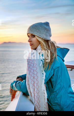 CANADA, Vancouver, British Columbia, female passenger enjoying the views at sunset of Discovery Passage in the Inside - Stock Photo