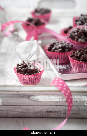 Rice crispies covered with milk chocolate - Stock Photo