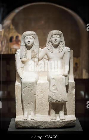 Turin. Italy. Egyptian portrait statue of Pendua and his wife Nefertari. New Kingdom, 19th Dynasty (1292-1190 B.C) - Stock Photo