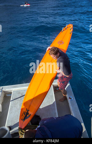 USA, HAWAII, Maui, Jaws, big wave surfer prepping his board before heading out to surf Peahi on the Northshore - Stock Photo