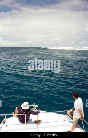 INDONESIA, Mentawai Islands, Kandui Resort,  watching surfers at Bankvaults from a boat - Stock Photo