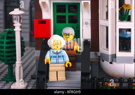 Tambov, Russian Federation - October 18, 2017 Lego senior couple standing on the porch of their house. Studio shot. - Stock Photo