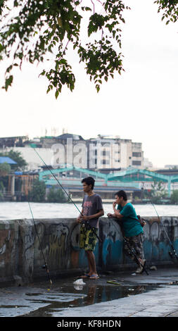 23 October, 2017 - Bangkok, Thailand: Two local men fishing - Stock Photo