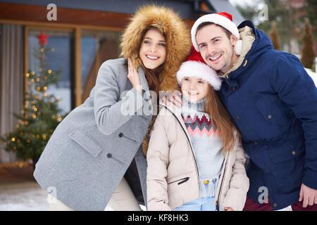 Family celebrating Christmas time outside - Stock Photo