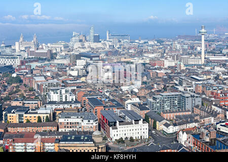 Looking down from above as mist clears from River Mersey & Liverpool waterfront buildings & other city centre landmarks - Stock Photo
