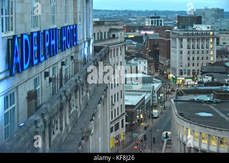 Early morning dawn view looking down from above at Liverpool city centre streets blue neon sign for Britannia Adelphi - Stock Photo