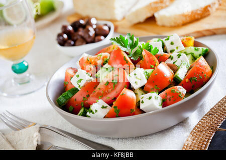 Homemade greek salad with tomatoes and cucumbers - Stock Photo