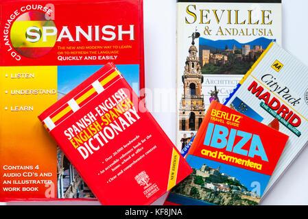 Spanish guidebooks, CD language course and Spanish - English dictionary - Stock Photo