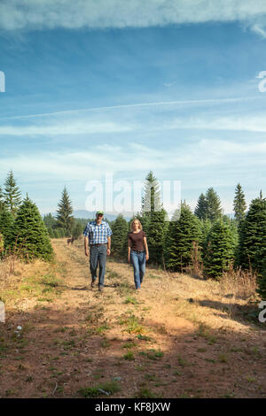 Noble man and woman walking together, death hiding behind ...