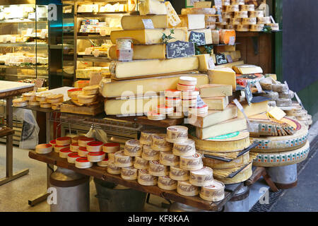 LONDON, UNITED KINGDOM - NOVEMBER 20: Cheese shop in London on NOVEMBER 20, 2013. A Variety of Cheeses for Sale - Stock Photo