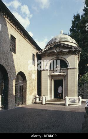 Rear view of a man in a tomb, Tomb of Poet Dante, Ravenna, Emilia-Romagna Region, Italy - Stock Photo