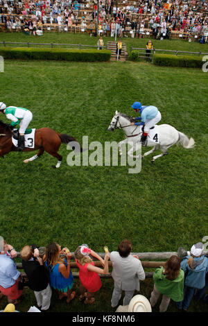 USA, Tennessee, Nashville, Iroquois Steeplechase, Jockeys and their horses pass under the wire during the second - Stock Photo