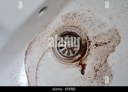 Dirty water going down the drain - Stock Photo