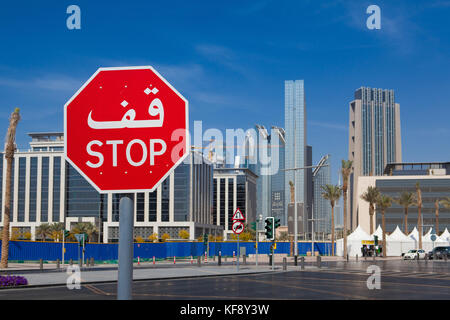 Dubai,United Arab of  Emirates - February 7, 2012: Bilingual stop sign in Dubai with both arabic and latin writing.Typical - Stock Photo