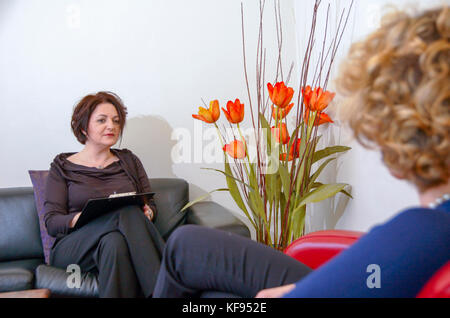 A female therapist during a one on one session with a client seeking help. Model release available - Stock Photo