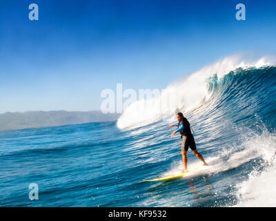 USA, Hawaii, Oahu a woman tow surfing on the North Shore of Hawaii - Stock Photo