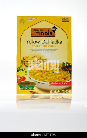 Box of prepared Indian Food Yellow Dal Tadka from Kitchens of India brand split lentil curry - Stock Photo